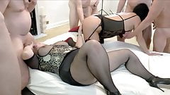 Two matures gangbanged