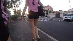 walking in the street with a candid tight short