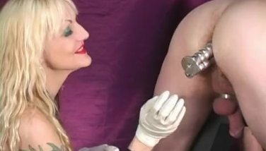 Kinky mature blonde Mistress training a slave in his ass with dildos